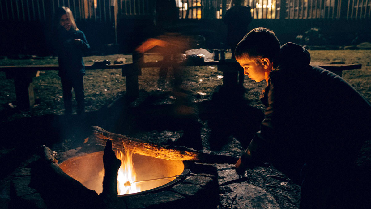 Two children roasting marshmallows at a fire (photo credit - Michael Aleo)