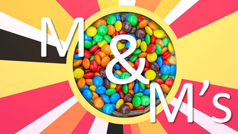 Bowl of M&M candies within a colorful background
