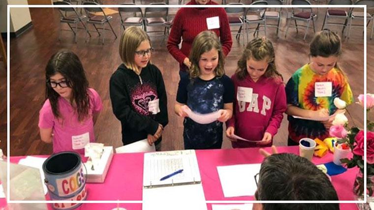 Young children alongside a table at the Sun Prairie United Methodist Church (Sun Prairie, WI)