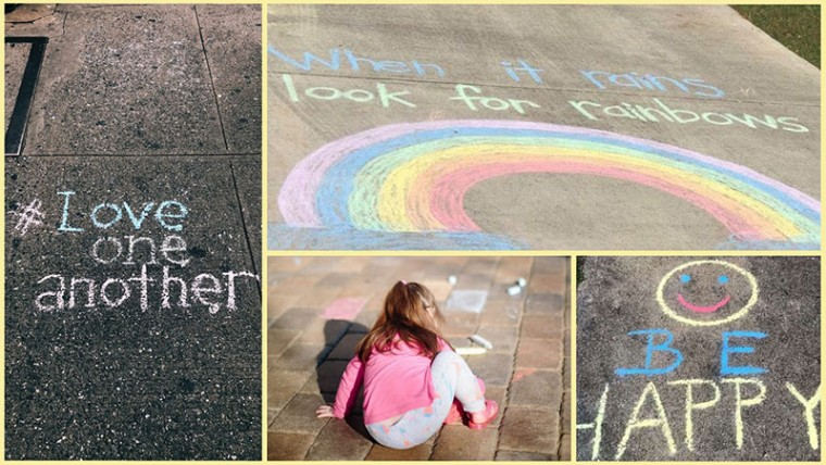 Child drawing inspirational images on the sidewalk with colored chalk