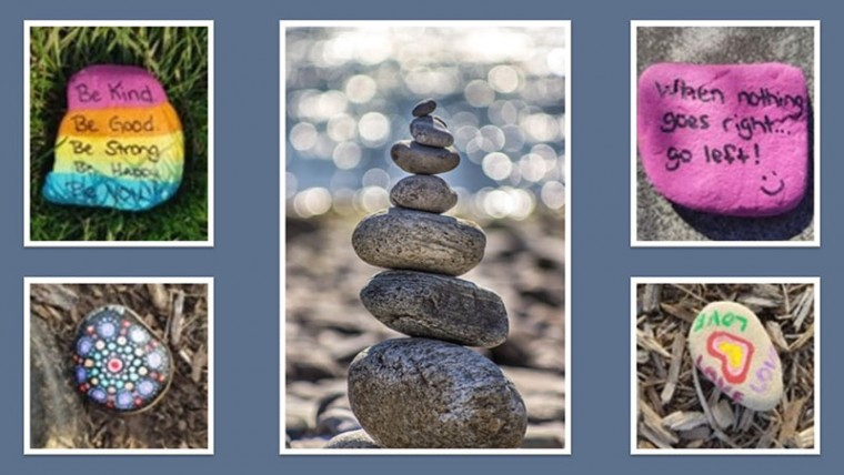 Stacks of stones, each with a message of inspiration